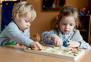 Children working on a puzzle together