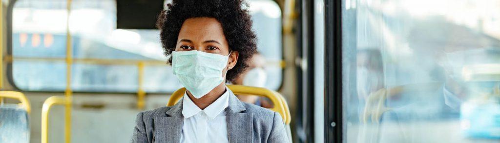 A bus passenger wearing a face mask.