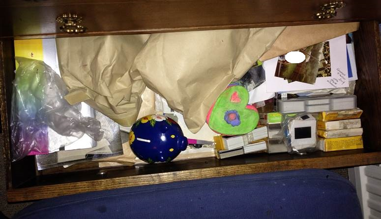 Drawer of memories: old photos and children's pots