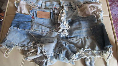 The extended life of denim shorts: loved and repaired, worth little on ebay