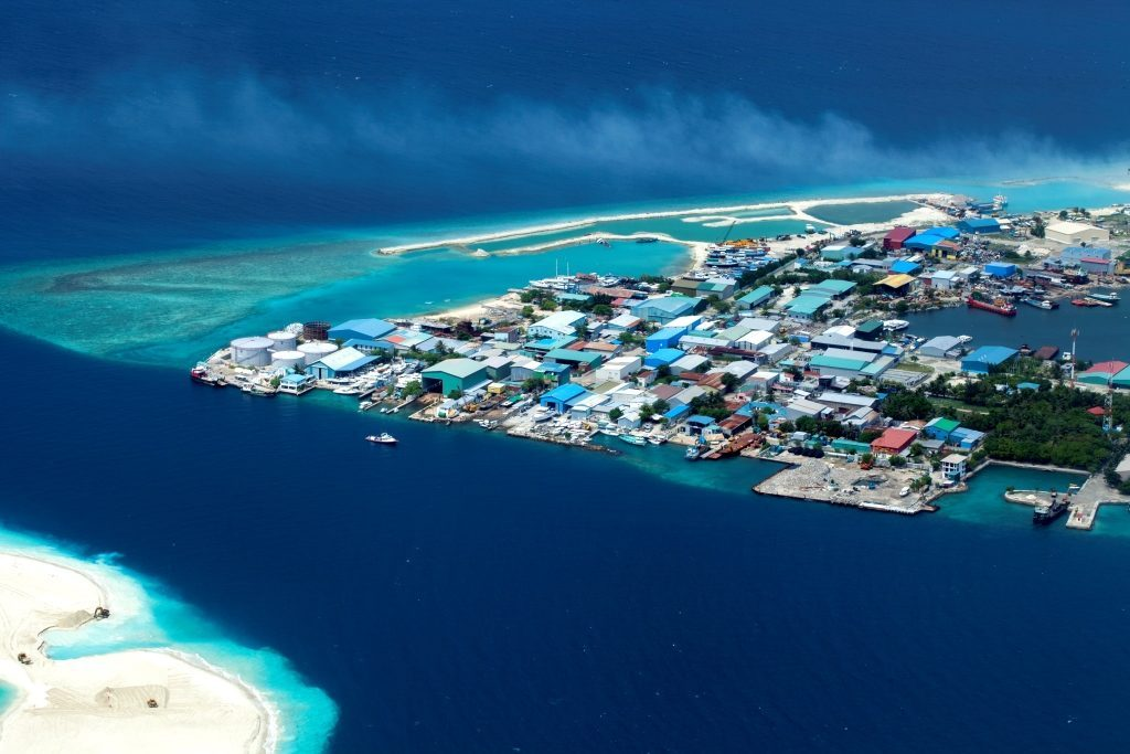 Aerial photo of town and beach