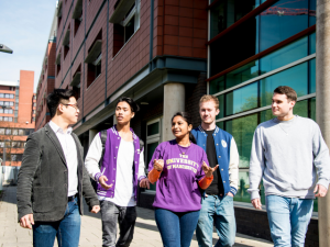 Students and lecturer walking around University campus