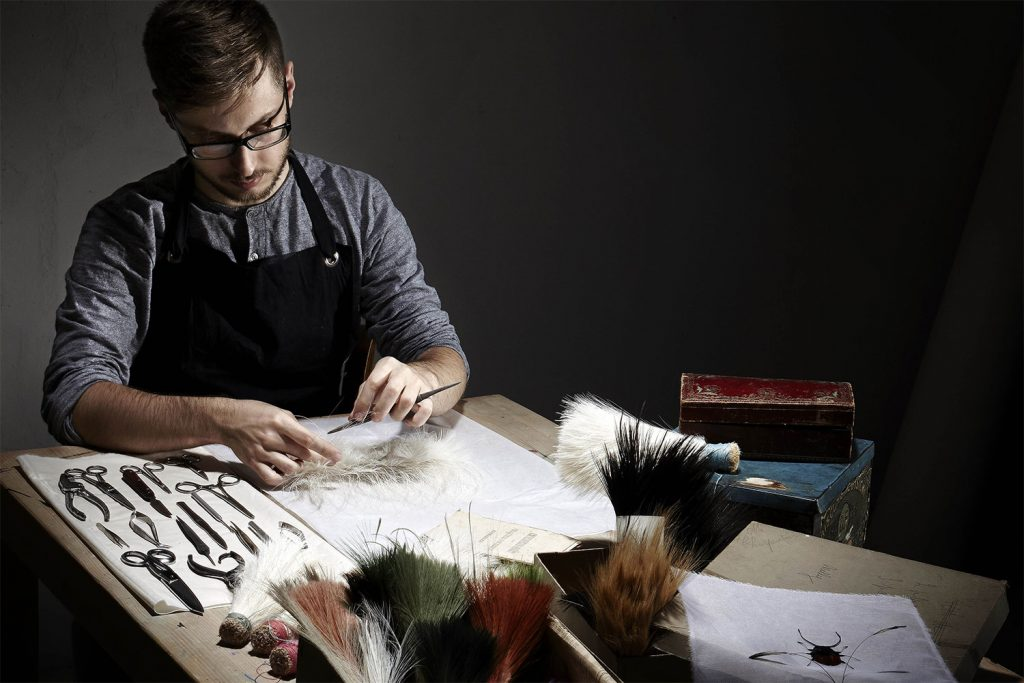 Man working with feathers