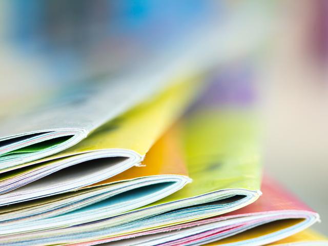 colourful brochures on a desk