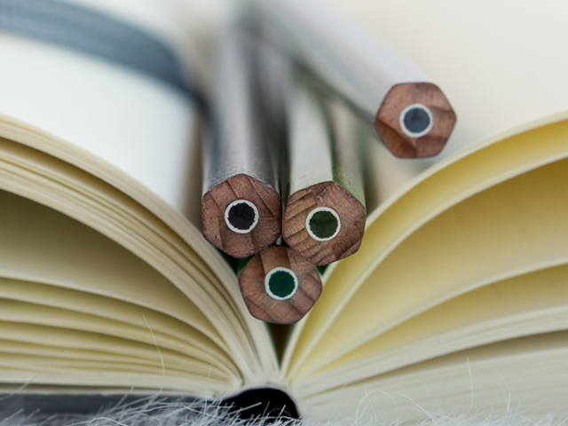 Pencils resting on the pages of an open book