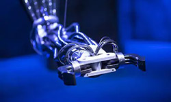 Image of a robot arm with its pincer open