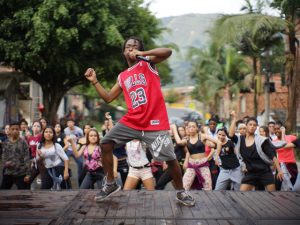 Crazy Dance lead an outdoor dance class in Columbia