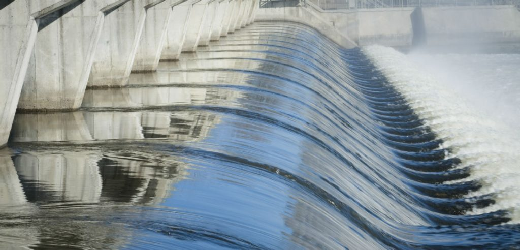 water-resources research-hydrology, water flowing over dam